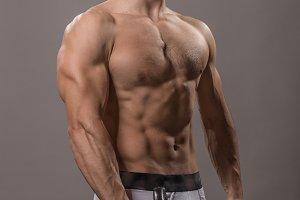 Bodybuilder posing studio upper body