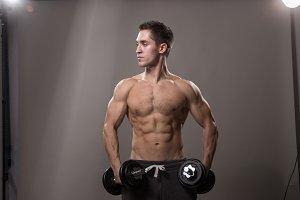 Bodybuilder muscular posing studio