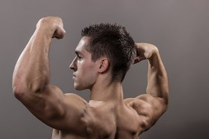 Bodybuilder back arms side view