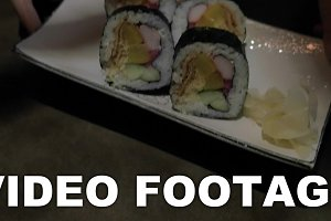 Serving sushi rolls in Japanese