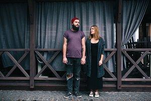 couple posing on a city street
