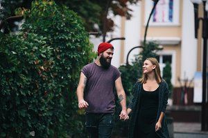 loving couple walking through the city