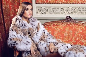 Fashion model posing in a fur coat