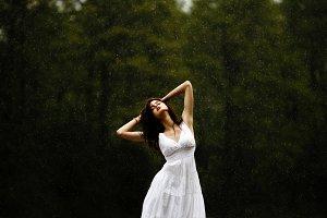 Sensual girl under rain