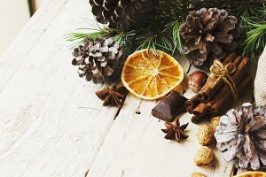 New Year or Christmas composition with walnuts, mulled wine, hazelnuts