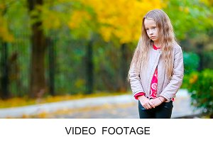 Portrait of little girl in fall