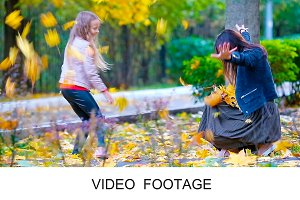Girl and mother enjoy fall in park