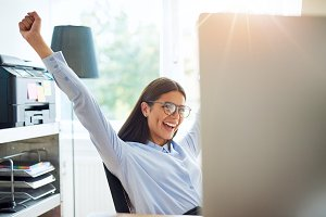 Entrepreneur in office with outstretched arms