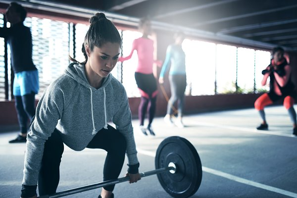 Fit healthy woman lifting a weight…