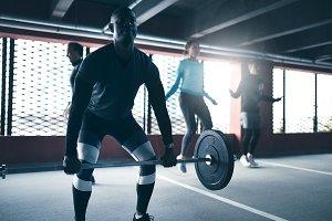Black man exercising lifting weight