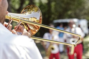 man playing the trumpet at outdoor