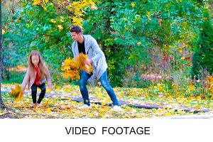 Family enjoy fall day in autumn park