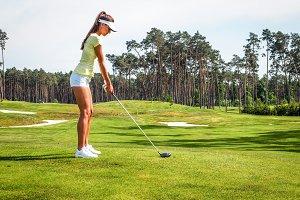 Sports woman playing golf