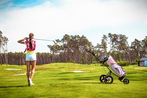 Woman hits the ball on the golf #3