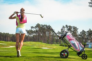 Woman hits the ball on the golf #4