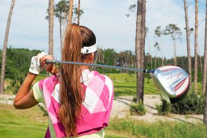 Woman hits the ball on the golf #5