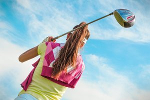 Woman hits the ball on the golf #6