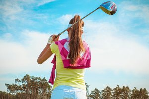 Woman hits the ball on the golf #7
