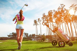 Woman hits the ball on the golf #8