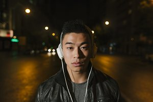 Asian man listening music.