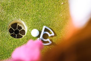 Golfer putting ball in hole #2