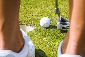 Golfer putting ball in hole #4