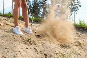 Golfer putting ball from sand #2