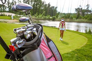 Golf bag with equipment and golfer