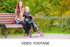 Little girl with mom enjoy fall day