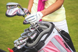 Golf bag with equipment and hands