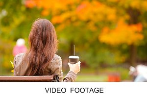Woman enjoy coffee in autumn park