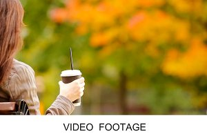 Woman enjoy coffe under fall foliage