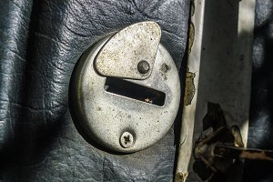 Old lock on the leather covered door