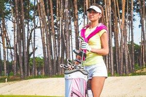Elegant golfer with her equipment