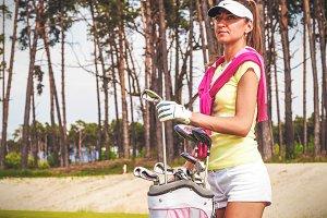 Elegant golfer with her equipment #2