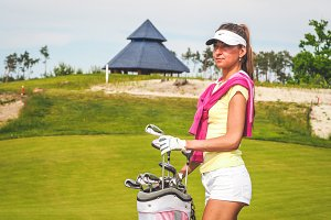 Elegant golfer with her equipment #3