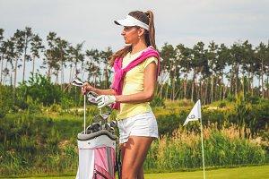 Elegant golfer with her equipment #4