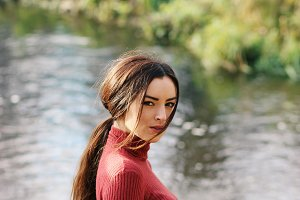 Beautiful woman near river