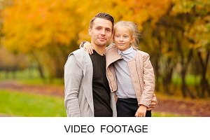 Little girl and happy father autumn