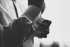 Man adjusts a cufflink