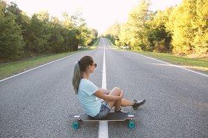 Girl with longboard.