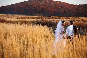 Bride and groom on the autumn field