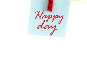 Note paper with the word happy day
