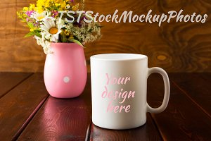 White mug mockup with wild flowers