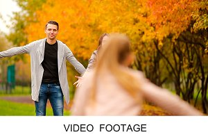 Girl and happy father enjoy autumn