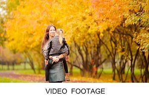 Adorable girl and mom enjoy fall day