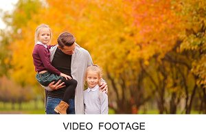 Portrait of happy family autumn park