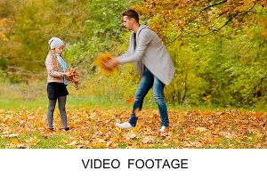 Cute girls with dad enjoy autumn