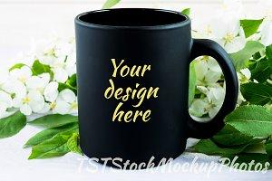 Black mug mockup with apple blossom