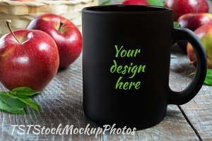 Black coffee mug mockup with apples